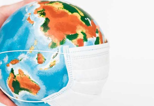 A globe wearing a germ mask depicting the spread of pandemic.